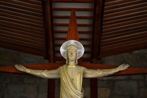 Post-Gazette photo of crucifix above Queen of Peace Chapel altar published with full permission