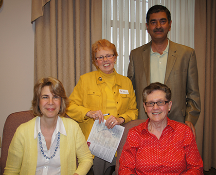 Members of the planning committee for the first annual Citizens of the World Wellness Conference include Julia Trimarchi Cuccaro, Sister Bernadette Manning (seated), Sister Judy Laffey, and Dr. Sadfar Chaudhary (standing).